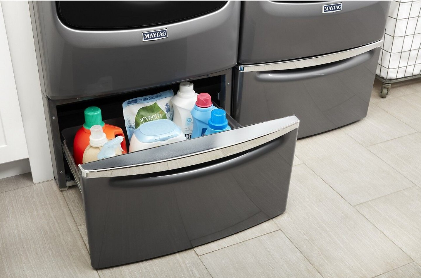 Grey laundry stand drawer open with detergent and dryer sheets inside