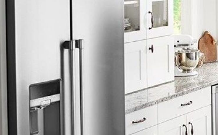 Counter-depth refrigerator flush with kitchen cabinets.