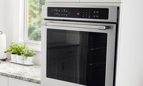 Maytag® wall oven in a white kitchen.
