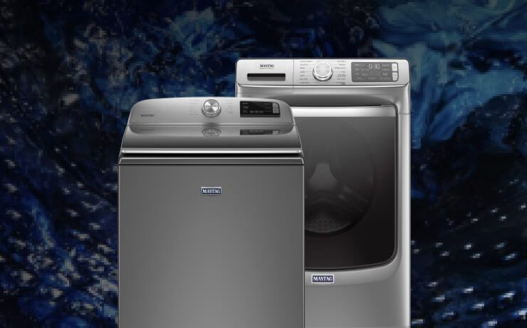 Interior view of a Maytag® washing machine cleaning blue clothes.