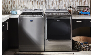 Laundry room with Maytag washer and dryer