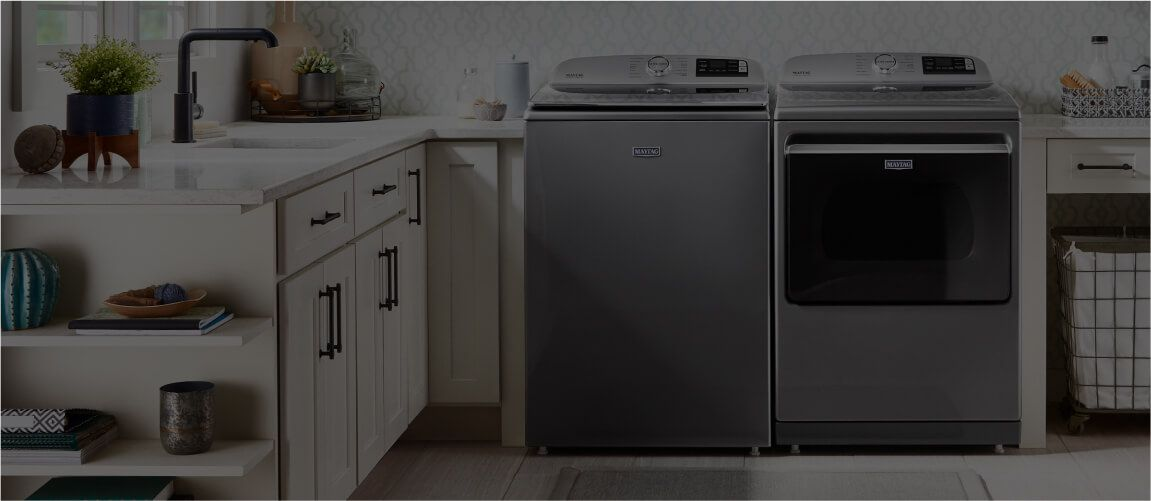 A laundry room arranged with a Maytag® washer and dryer.