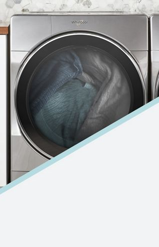 A blue knit scarf being washed in a top loading washing machine