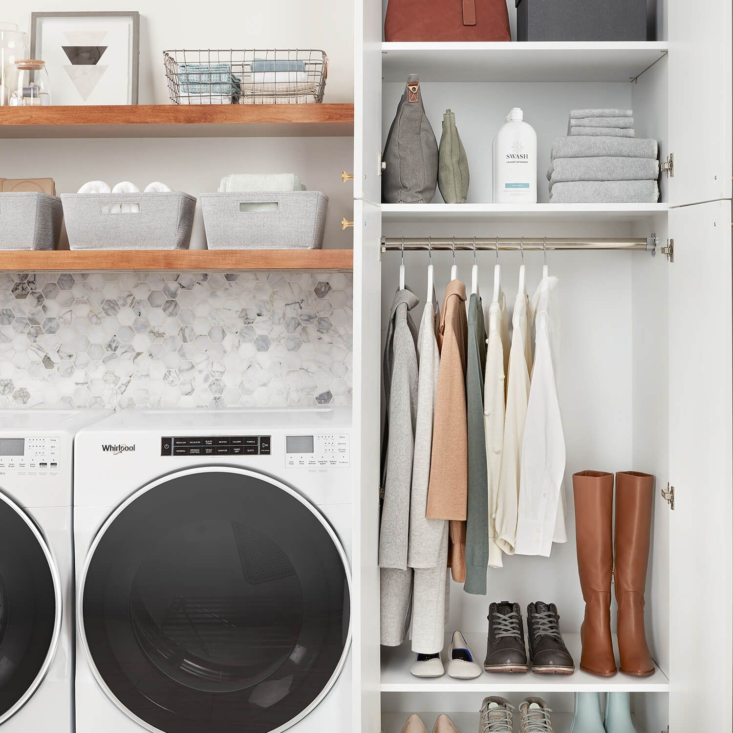 A look at inside of a cabinet in a laundry room with hanging space that is neatly organized next to a white Whirlpool washer and dryer