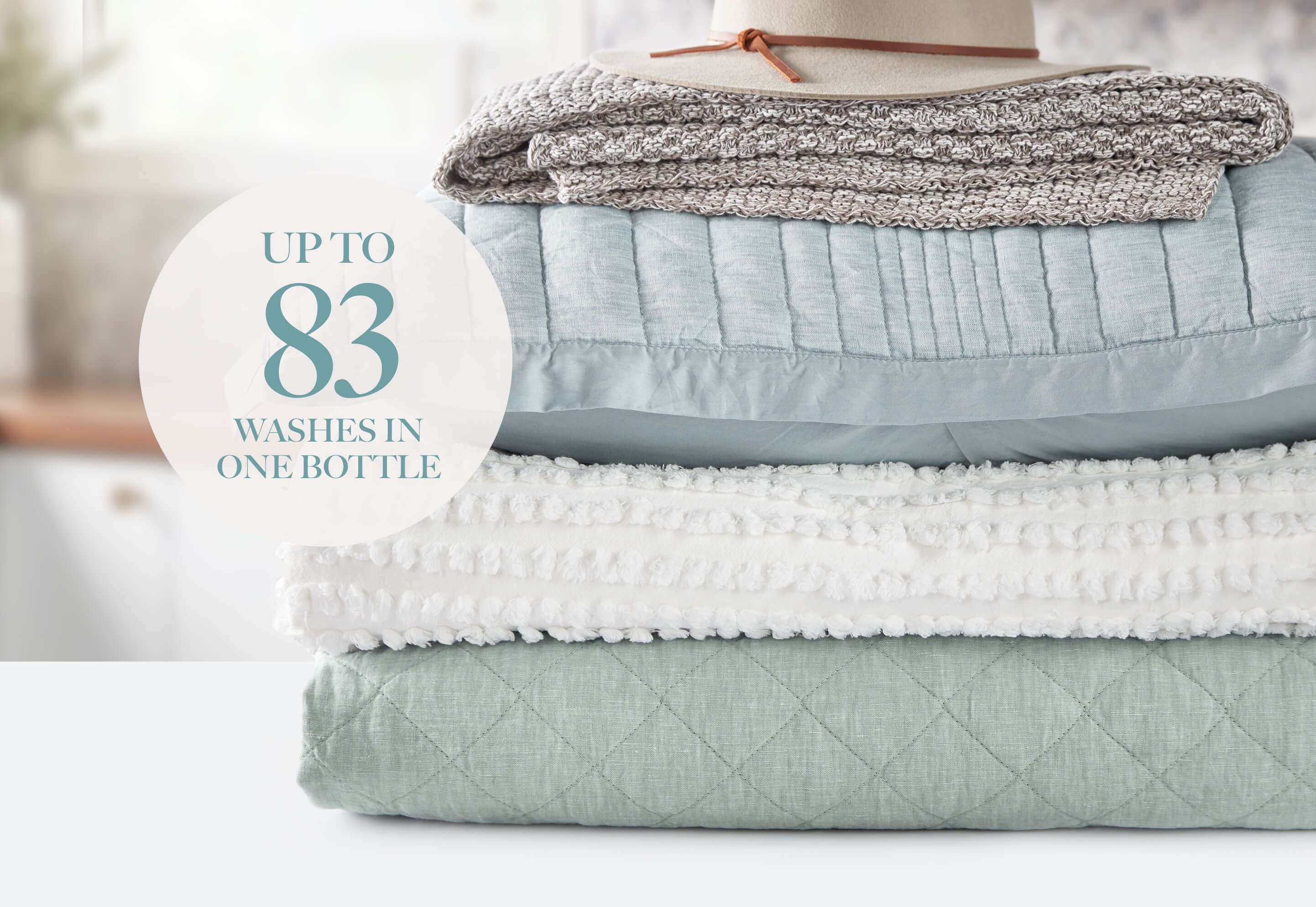 A stack of fresh laundry on a white countertop.