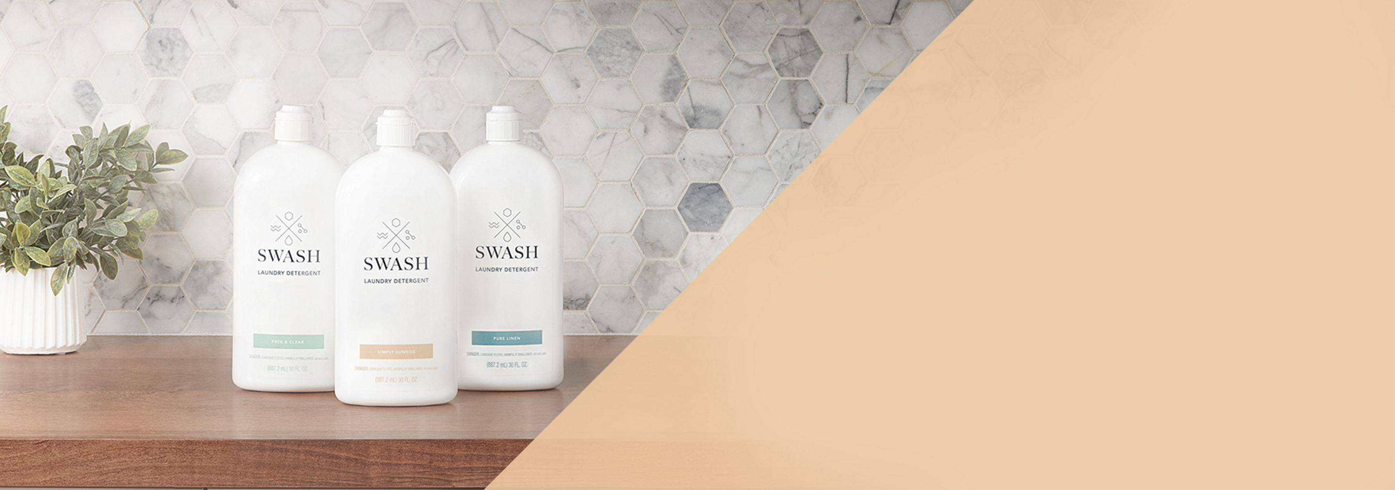 Swash Pure Linen Laundry Detergent laying flat amongst some fresh laundry