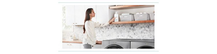 A woman puts a bottle of Swash laundry detergent on a shelf in a laundry room.