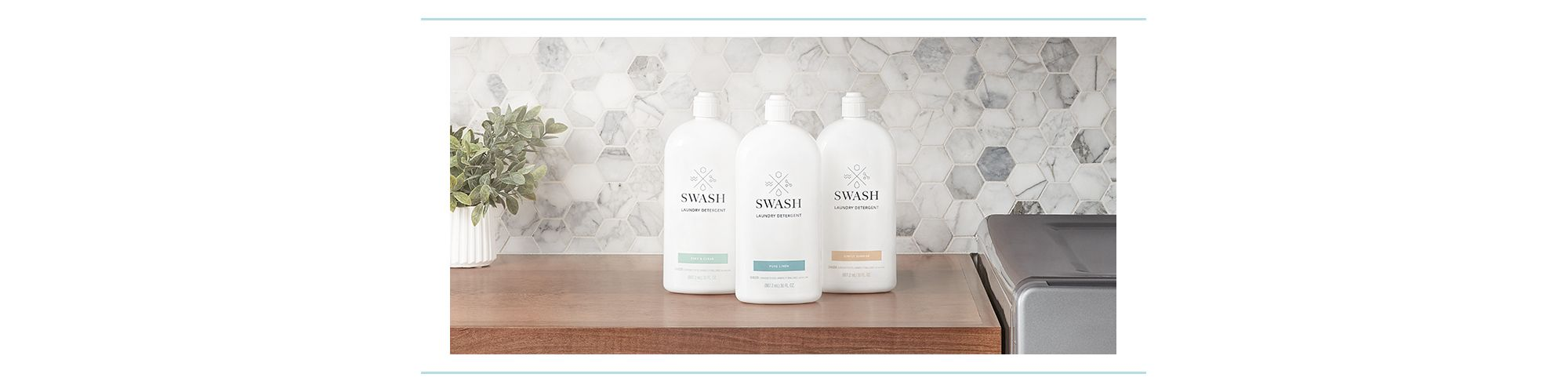 Three bottles of Swash lined up on a counter.