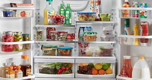 A Whirlpool® refrigerator loaded with a variety of foods