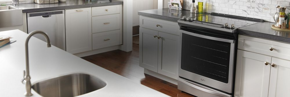 A kitchen with a Whirlpool® range.