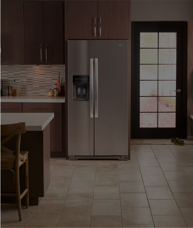 Whirlpool® kitchen suite featuring a range, side-by-side refrigerator and front-control dishwasher.