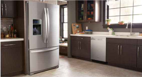 A kitchen featuring a Whirlpool® refrigerator.