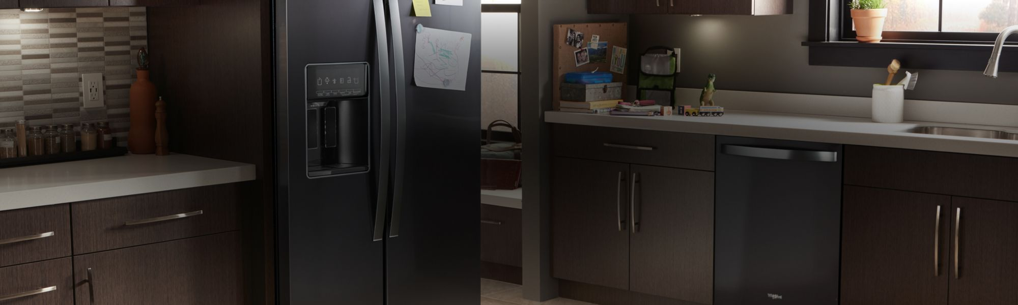 A Whirlpool® kitchen appliance suite featuring the low-profile microwave hood combination.
