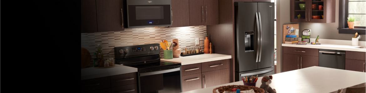 A Whirlpool® French door refrigerator in a sleek home kitchen.