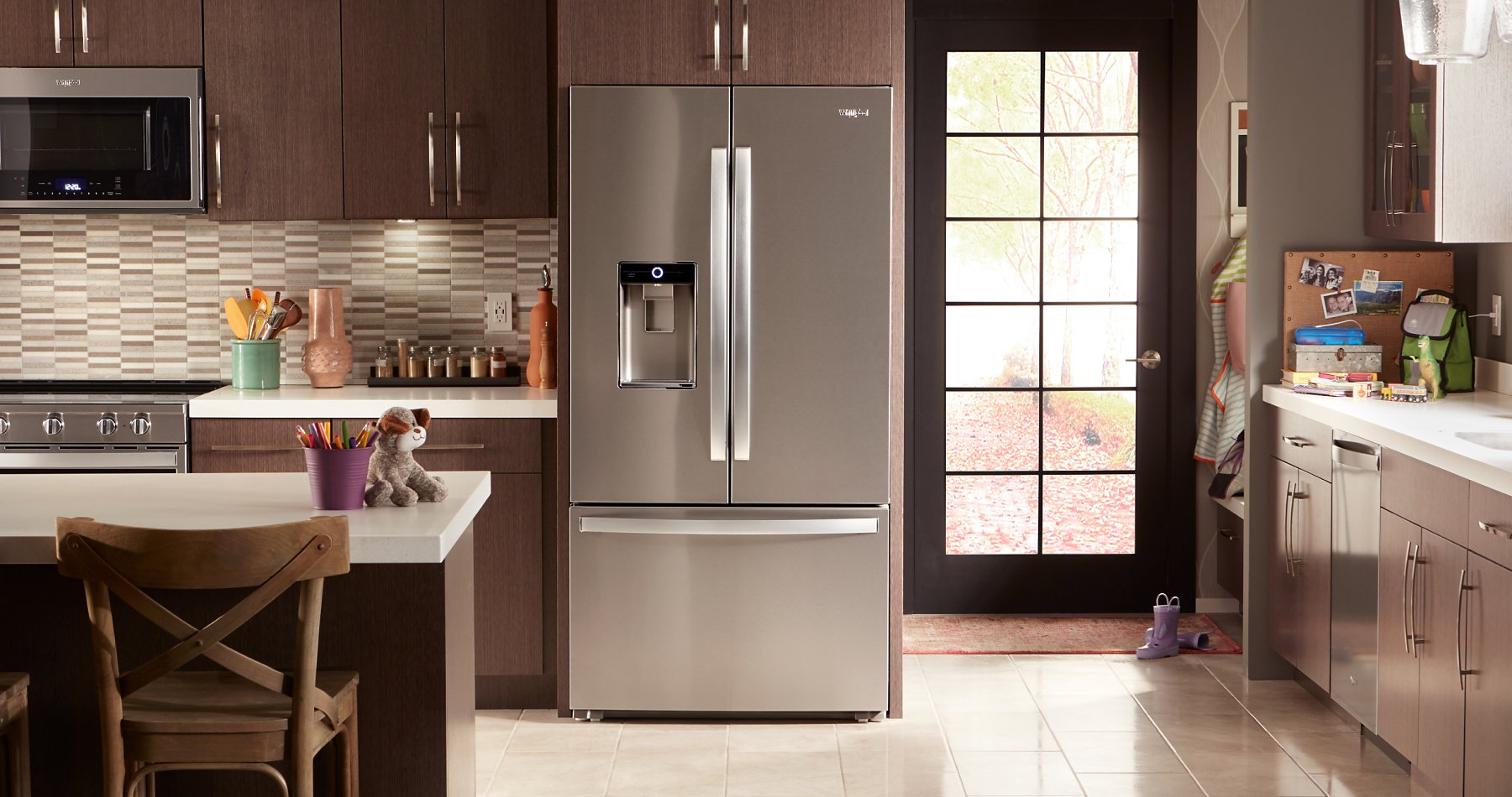 Multiple kitchen appliances are shown in a well-appointed kitchen.