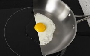 A pan cut in half on an induction cooktop.
