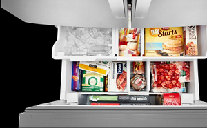 Open bottom freezer drawer with food and ice.