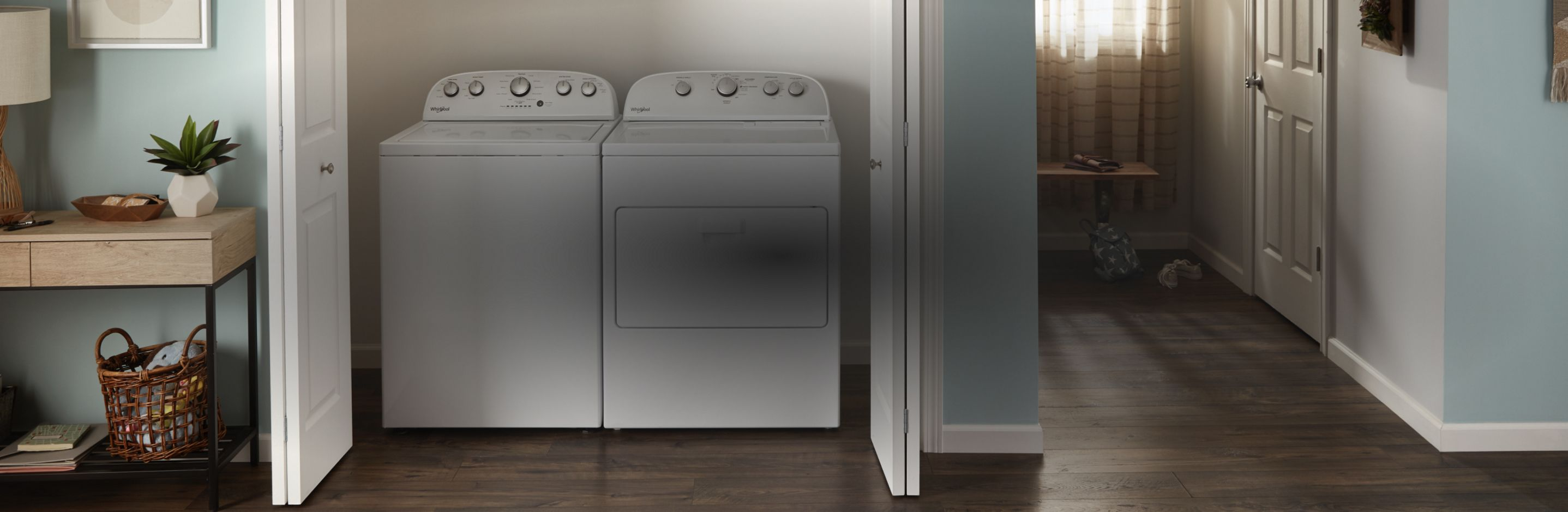 A kitchen equipped with a black Whirlpool® refrigerator.