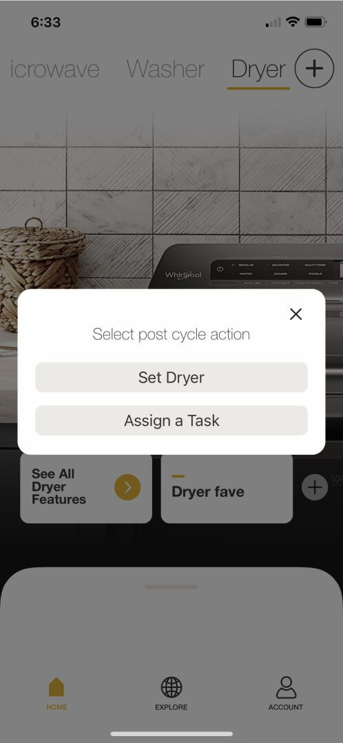 Getting a cycle suggestion from the Whirlpool® App on a smartphone