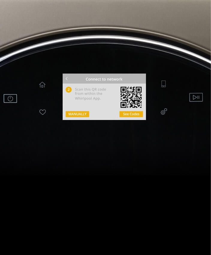 Using a smartphone to check on a meal cooking in the smart oven