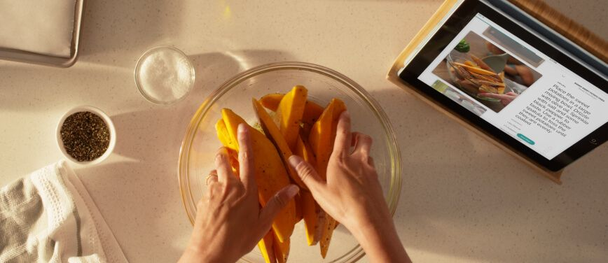 Preparing food with Yummly® Guided Recipe open on a tablet