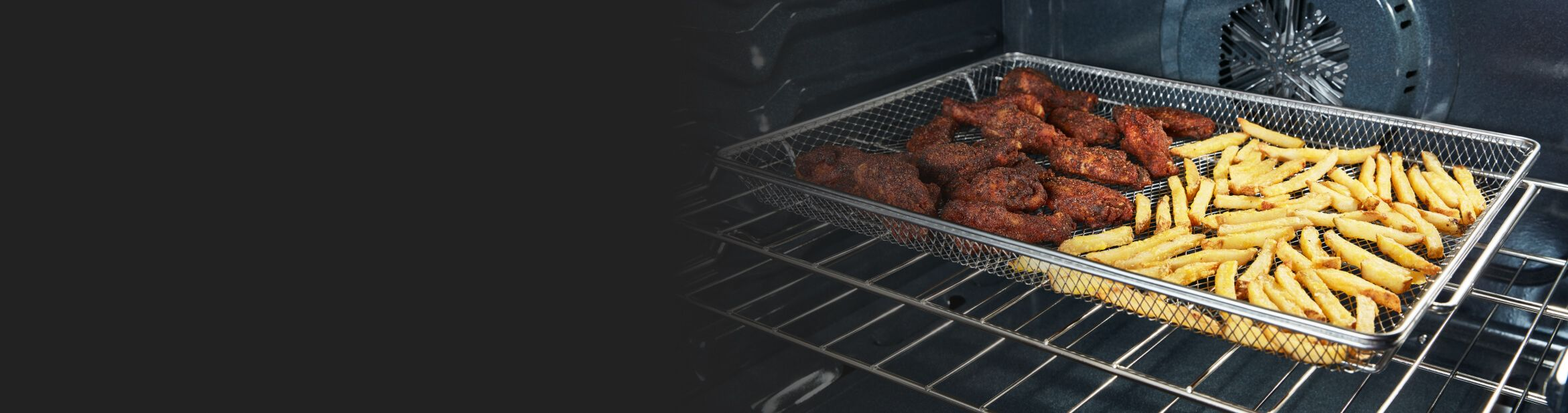 Food frying inside a Whirlpool® Range with Air Fry Mode.