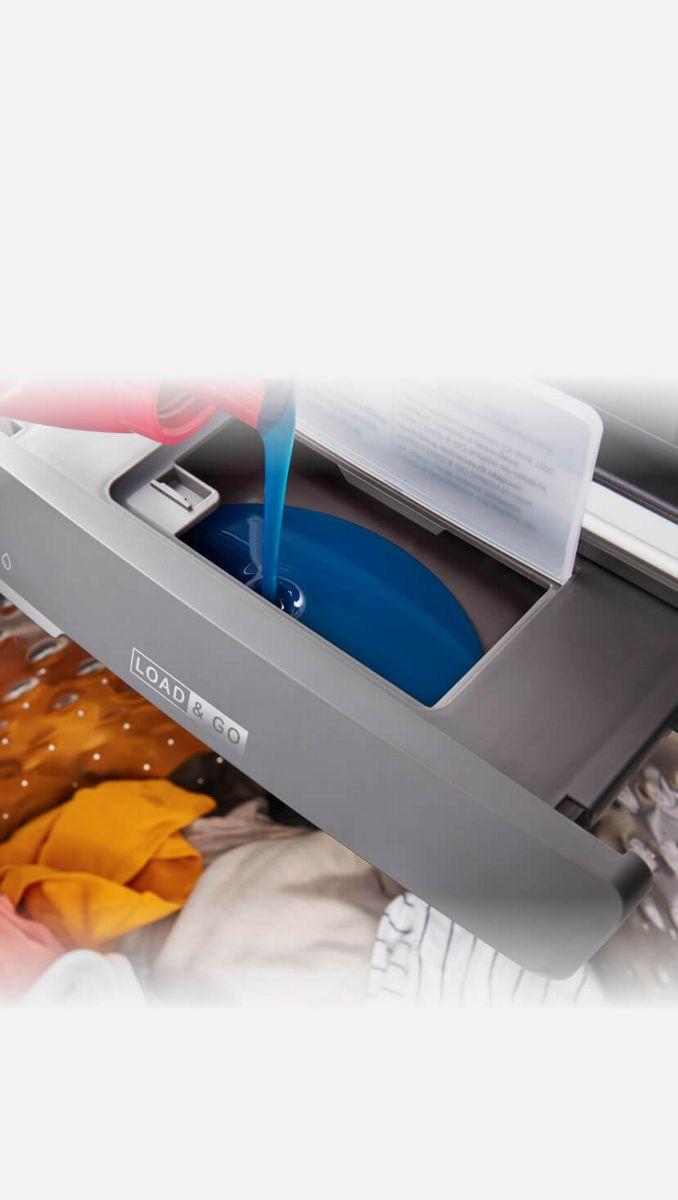 Filling the Load & Go™ dispenser with detergent