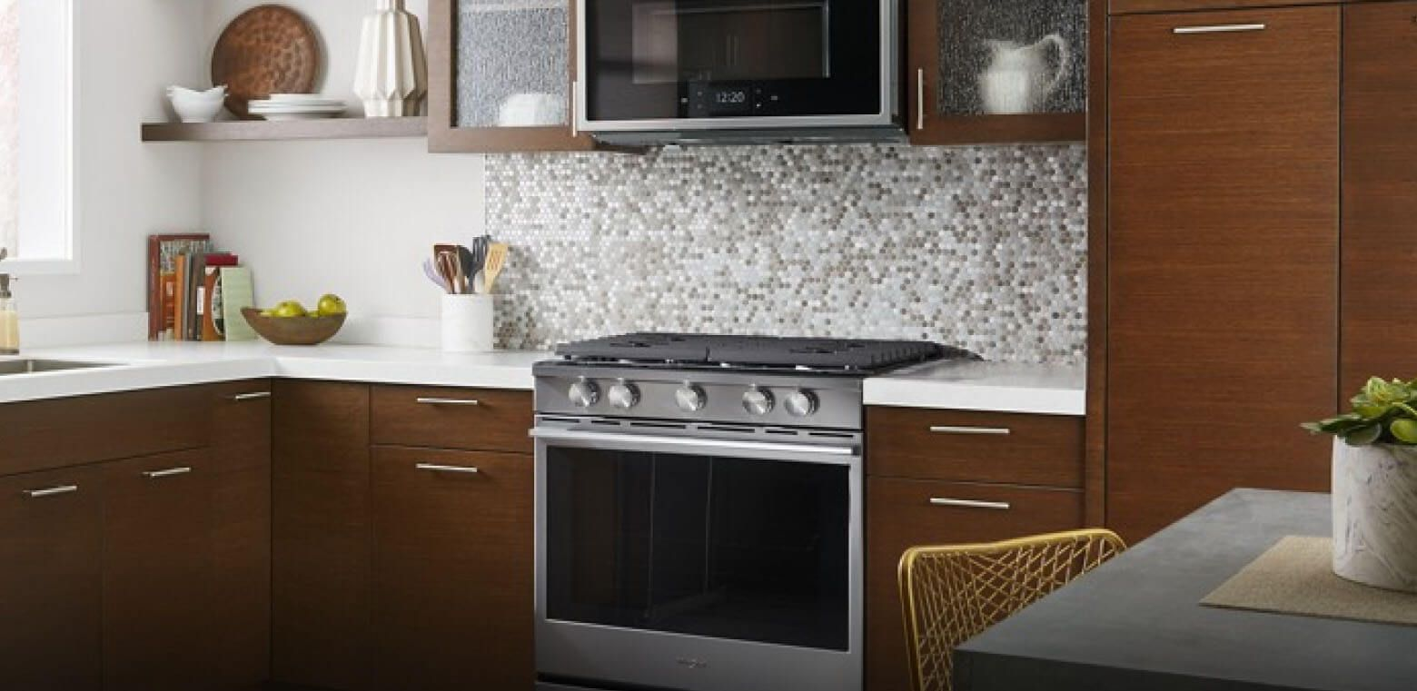 A kitchen with a Whirlpool® range and microwave