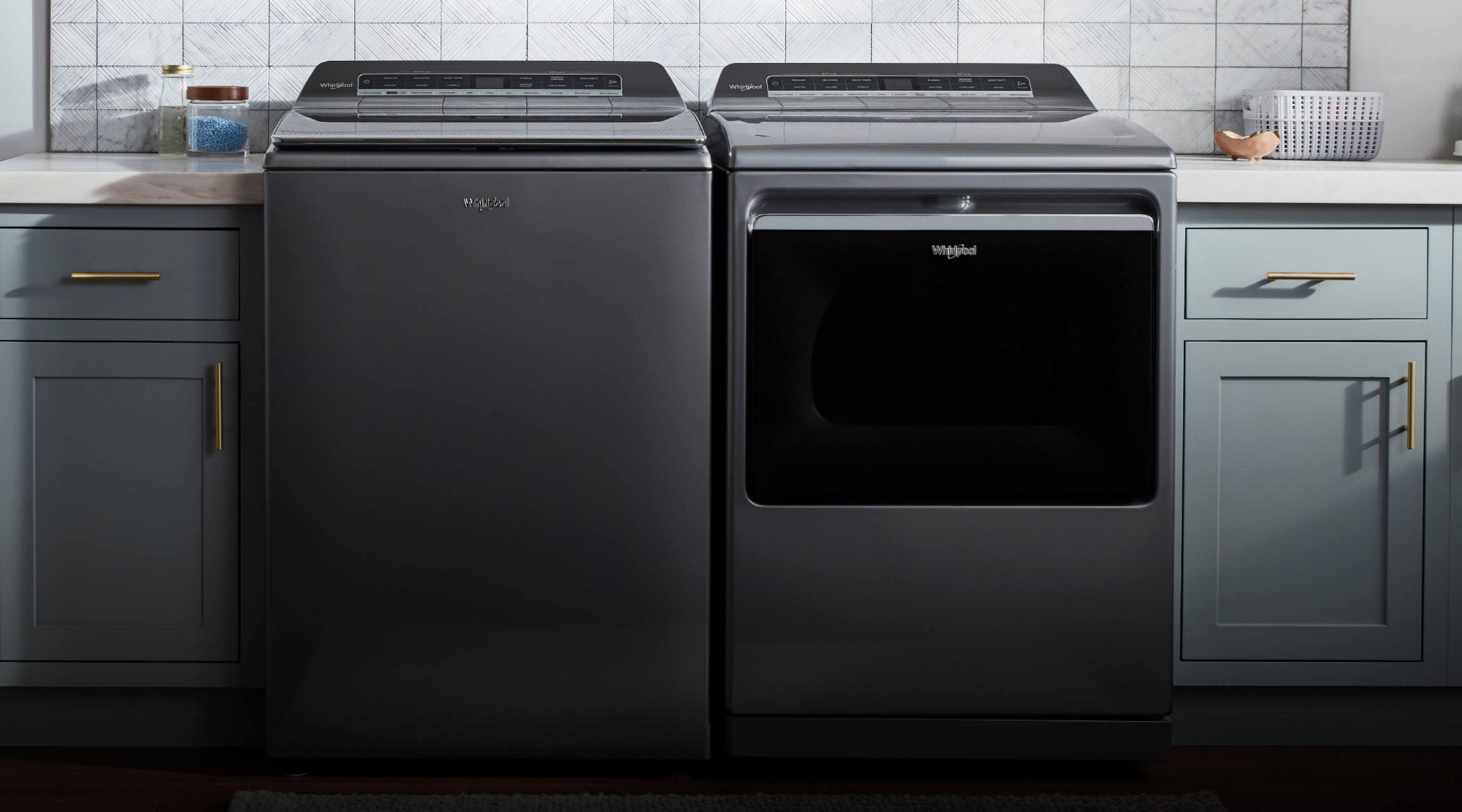 Whirlpool® Smart Capable Top Load Washer and Dryer in a laundry room