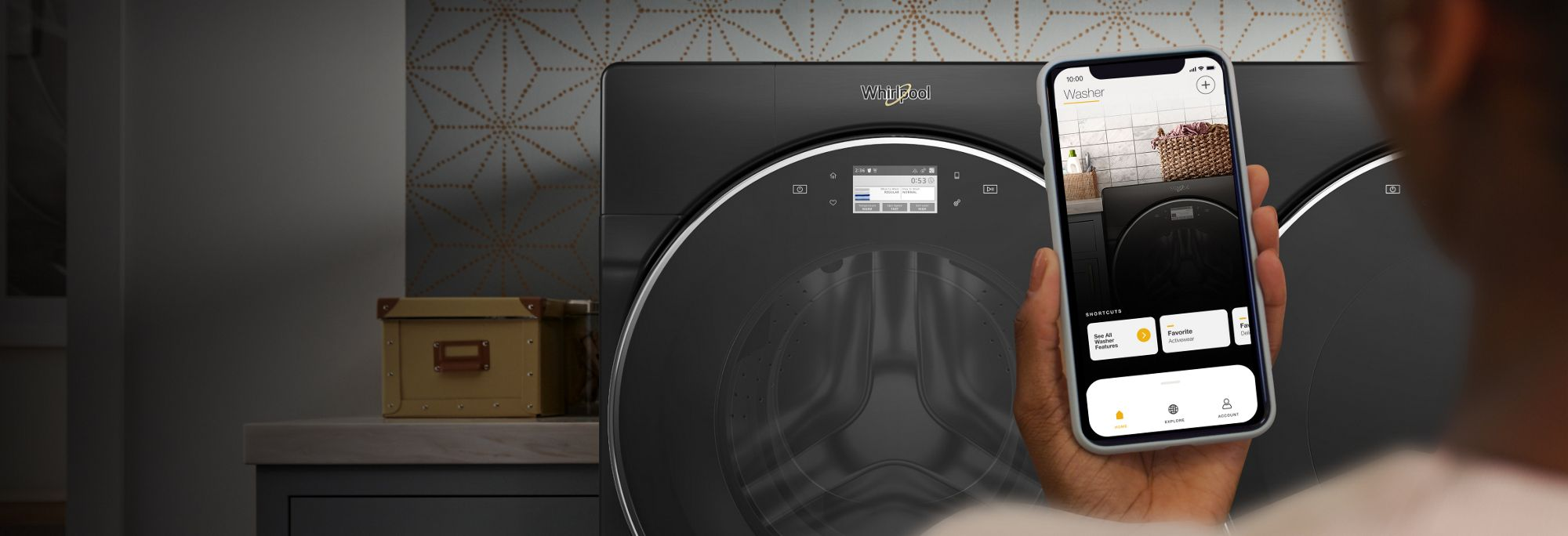 Smartphone with My Home screen in the Whirlpool® App in front of laundry pair