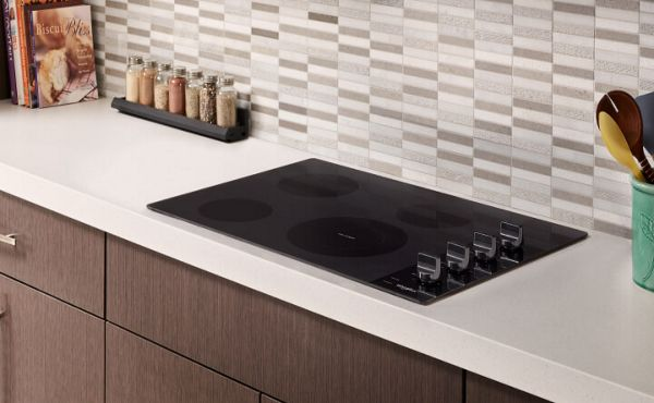 Electric cooktop built into a white countertop