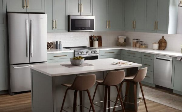 French door refrigerator in a modern kitchen with an island
