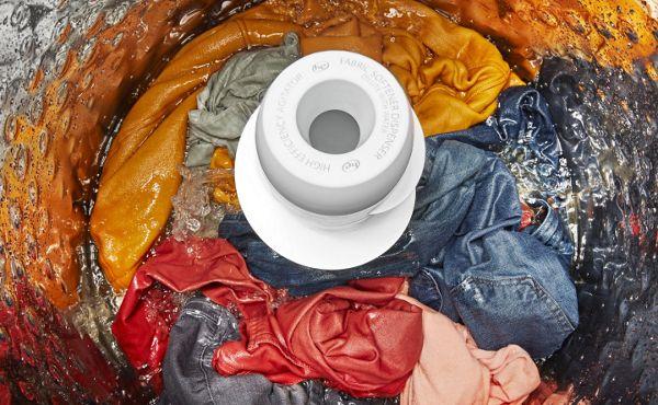 Inside view of a washing machine washing clothes
