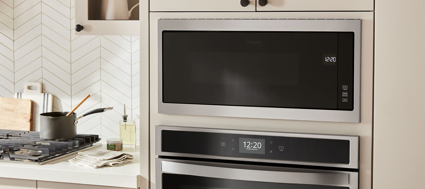 Built-in microwave in wall above built-in wall oven.