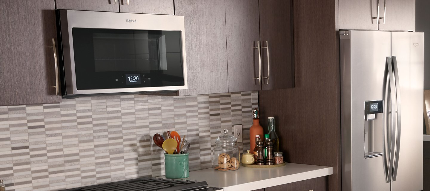 Whirlpool® Over-the-Range Convection Microwave in brown cabinetry