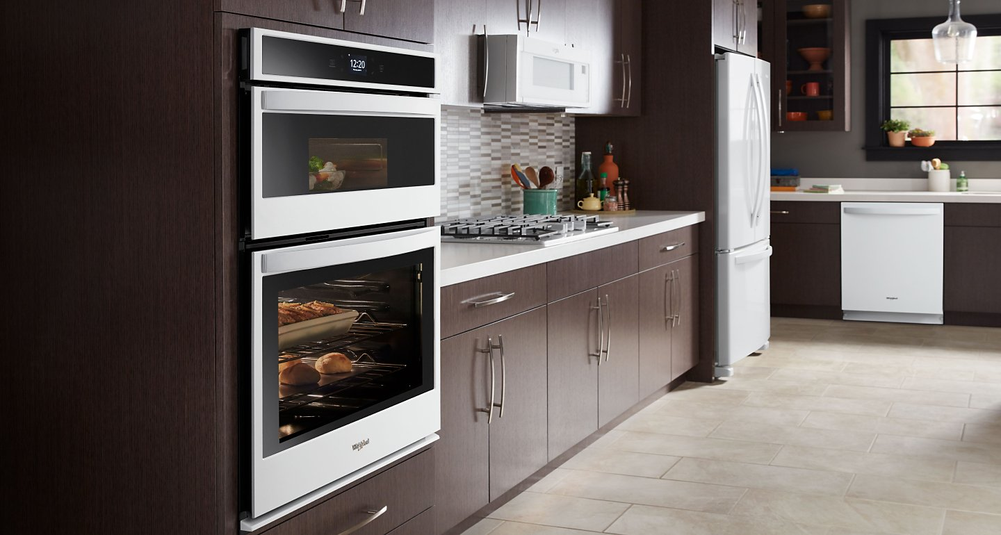 Whirlpool® Wall Oven and Microwave Combination in brown cabinetry