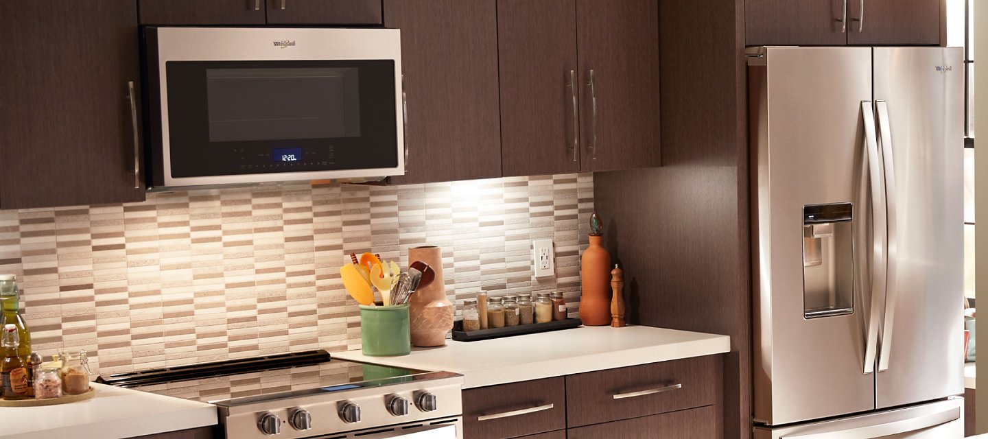 Whirlpool® Over-the-Range Smart Microwave in brown cabinetry