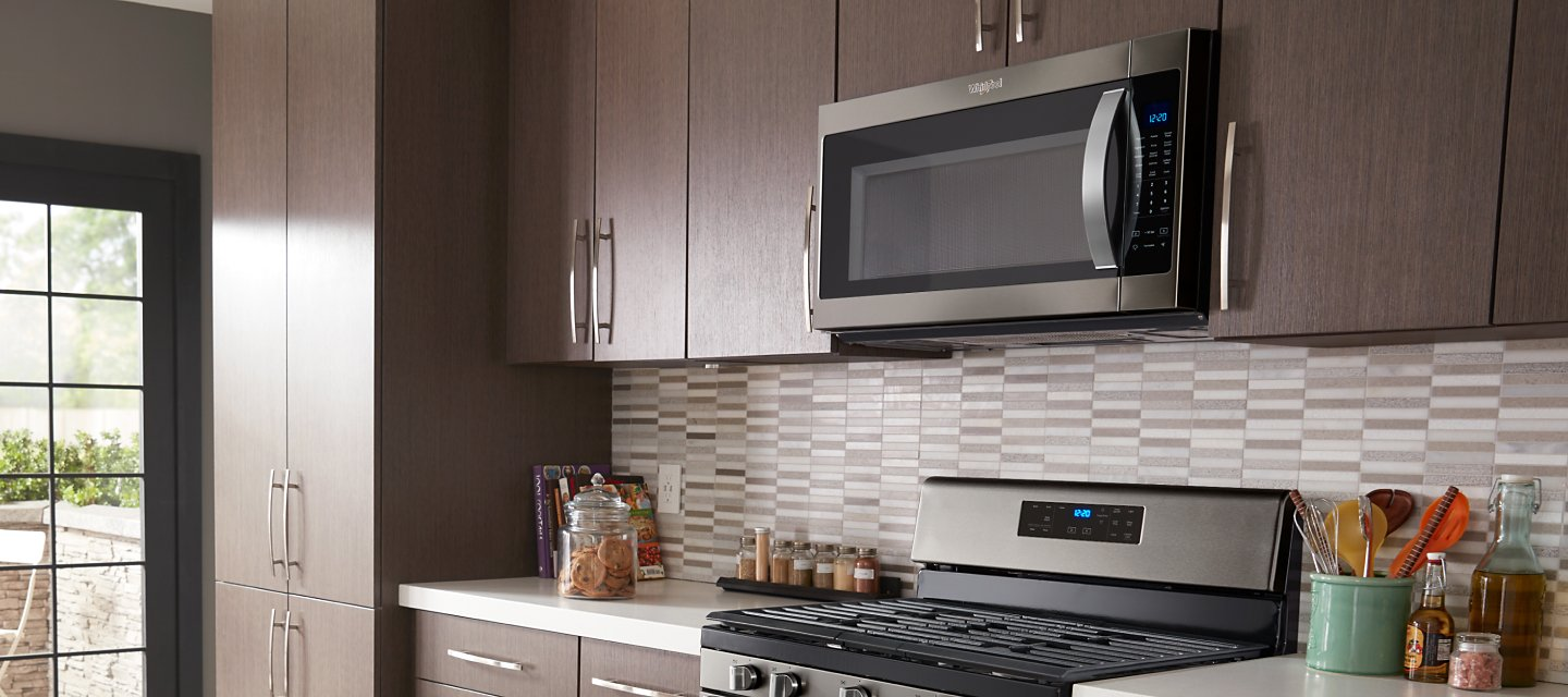 Whirlpool® Over-the-Range Microwave in brown cabinetry