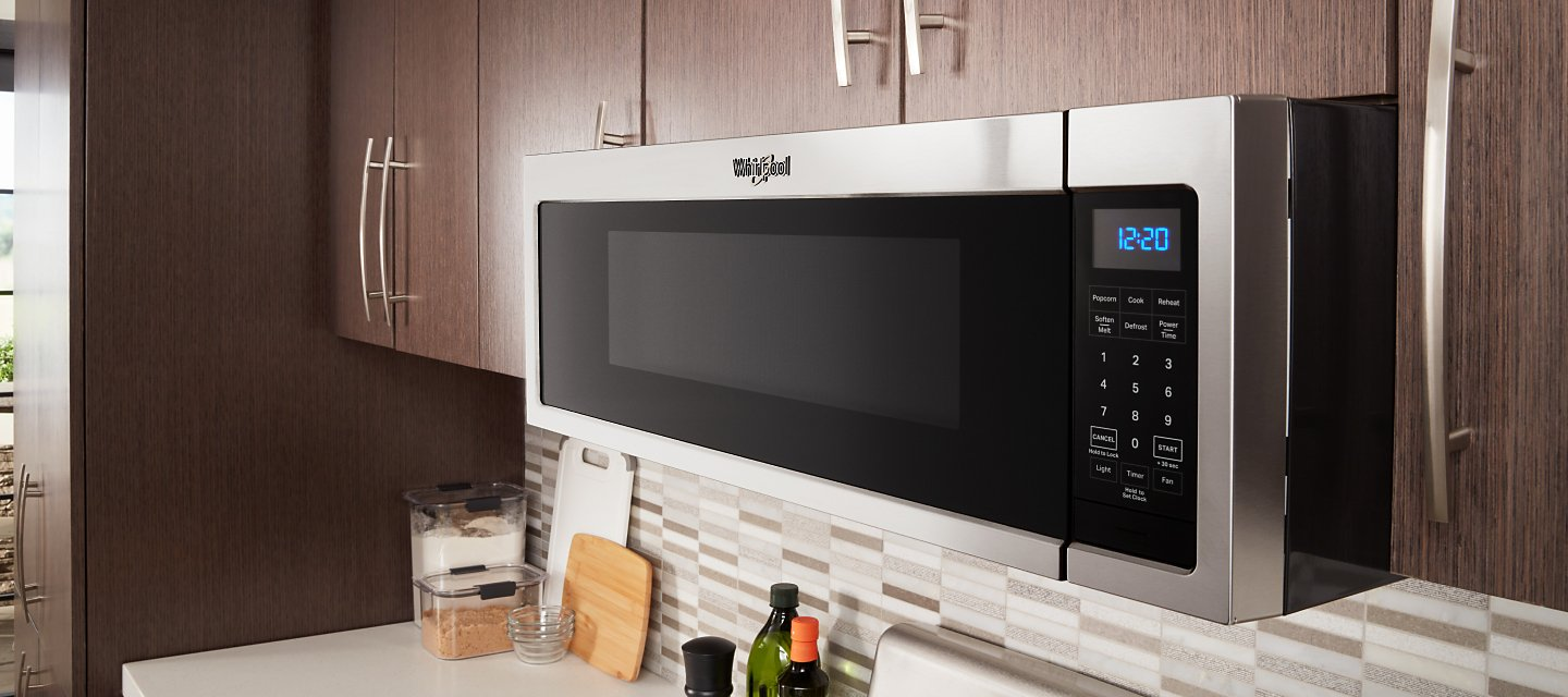 Whirlpool®  Low Profile Microwave in brown cabinetry