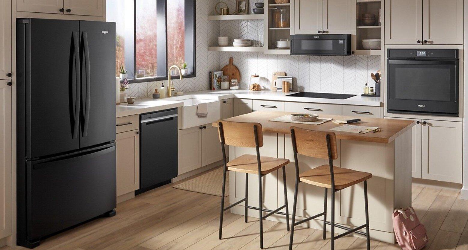 Kitchen featuring Whirlpool® appliances in black