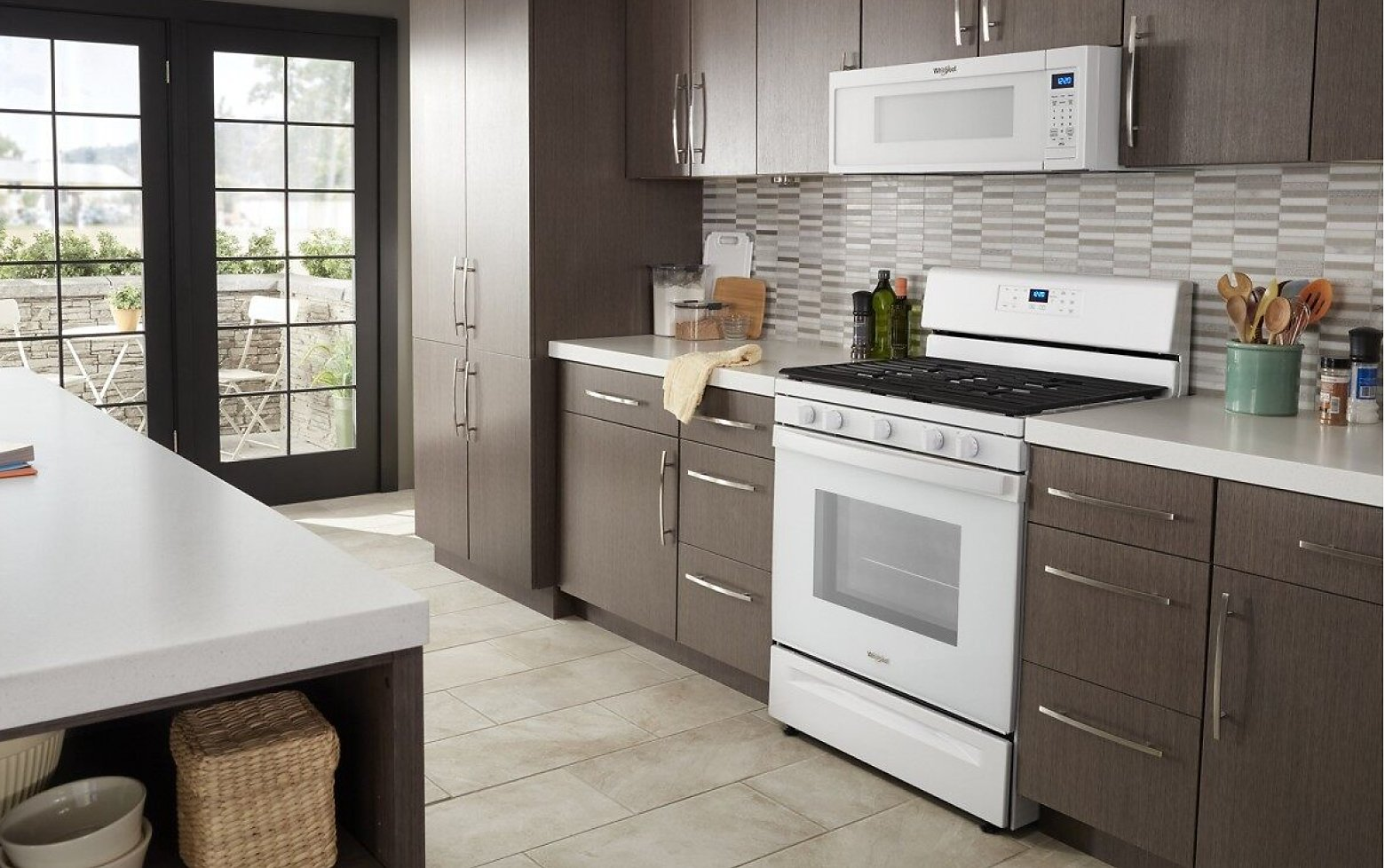 Kitchen featuring Whirlpool® range and microwave in white