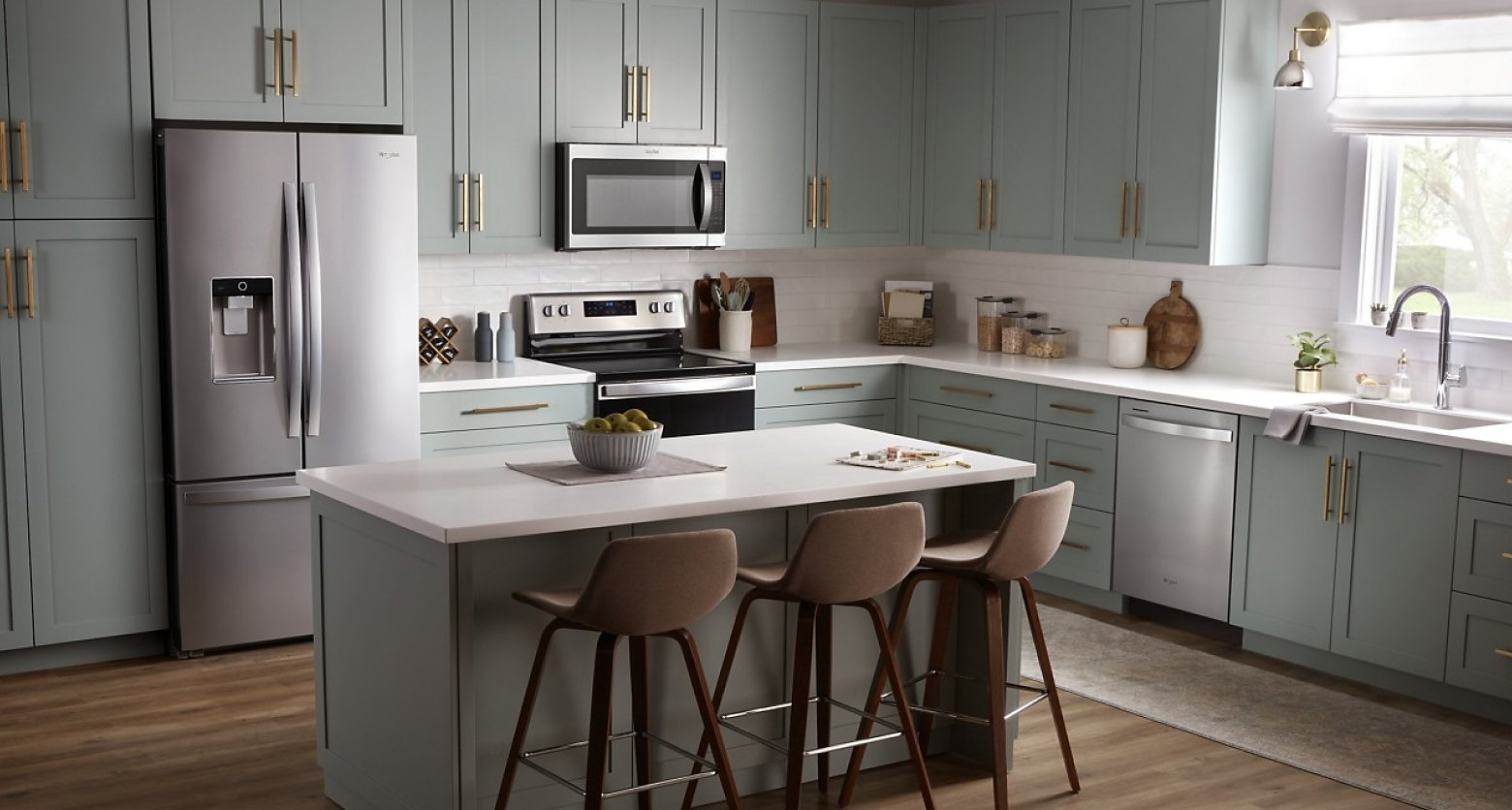 Gray kitchen featuring Whirlpool® stainless steel appliances