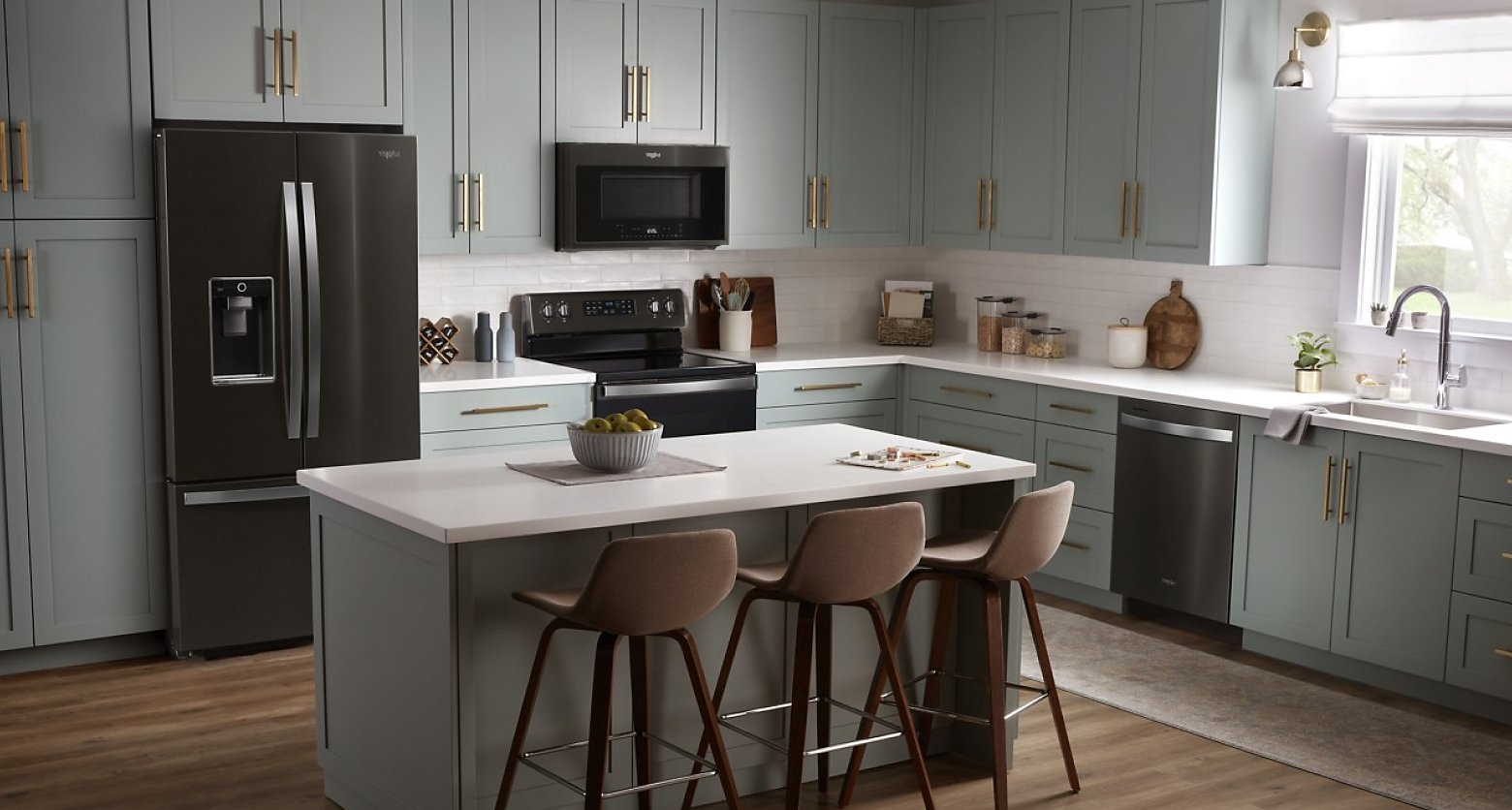 Gray kitchen featuring Whirlpool®  appliances in black stainless steel