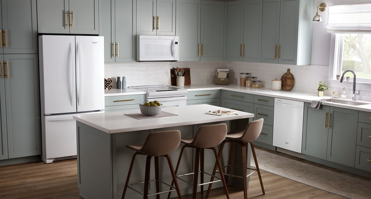 Gray kitchen featuring Whirlpool®  appliances in white