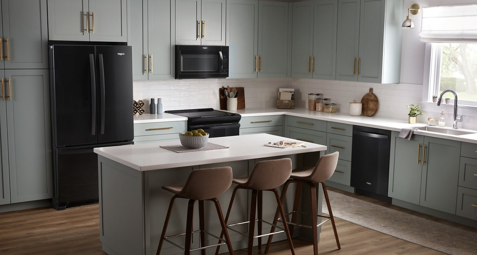 Gray kitchen featuring Whirlpool®  appliances in black