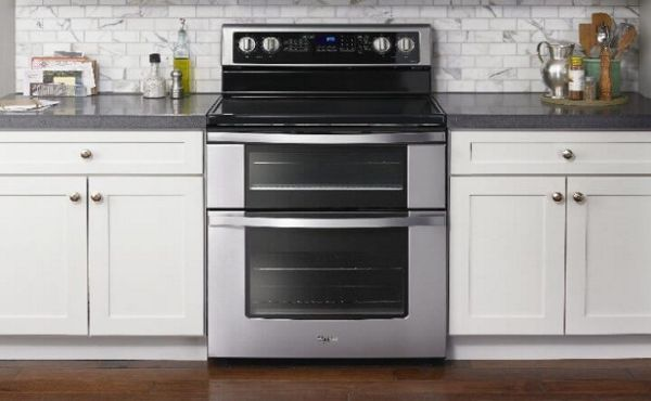 Whirlpool brand double oven range in modern kitchen