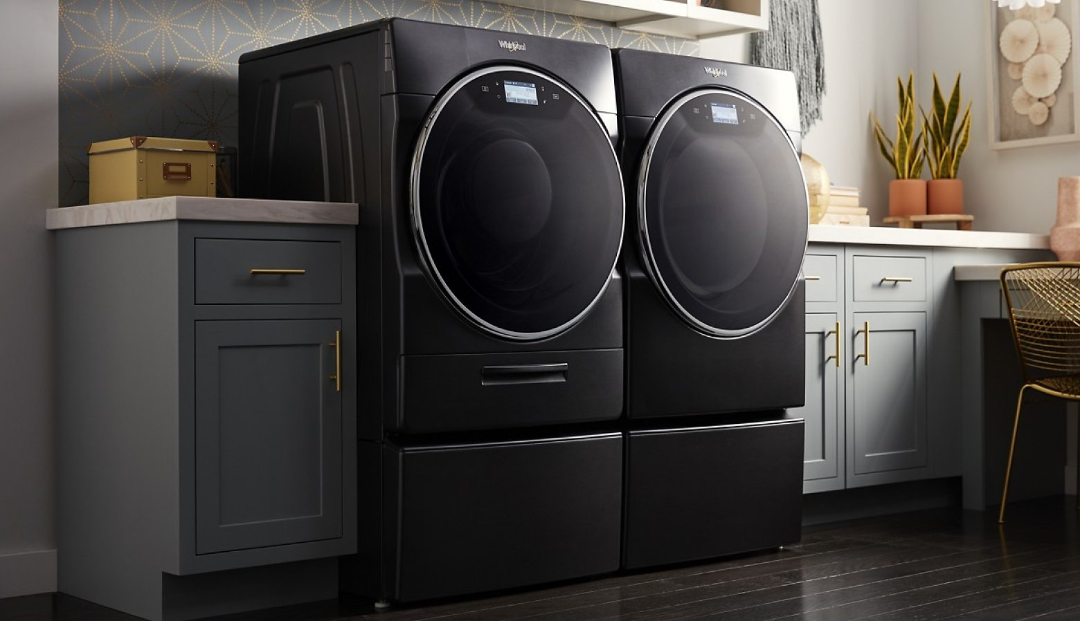 A front load washer and dryer in a white laundry room.