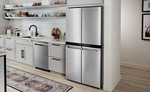 A Whirlpool® 4 Door Refrigerator in a white kitchen