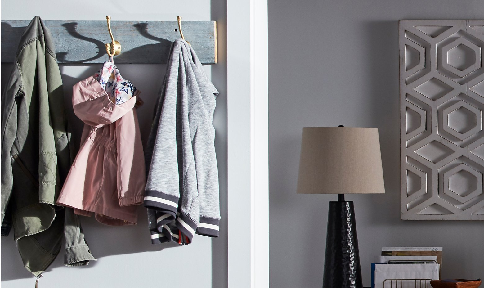 Clothes hanging on a rack in modern living room