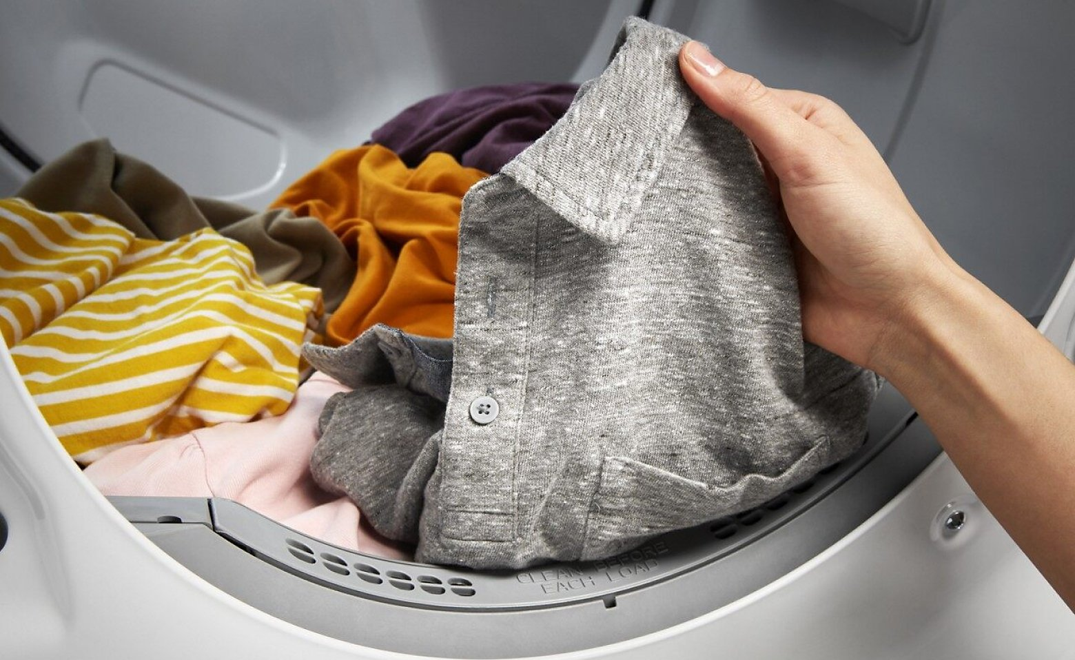 Hand removing clothes from the dryer